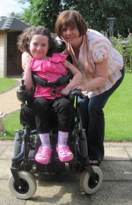 Female child in a wheelchair with carer